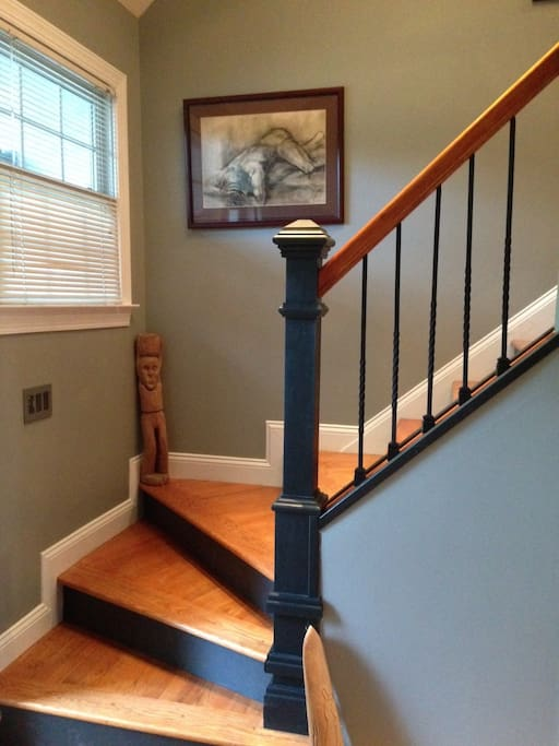 hardwood floors in main living area and stairs.