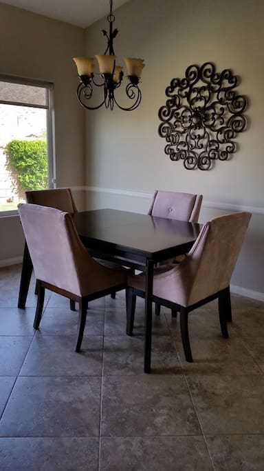 Chocolate maple dining table with suede chairs used for food soiree mon fils au jour.