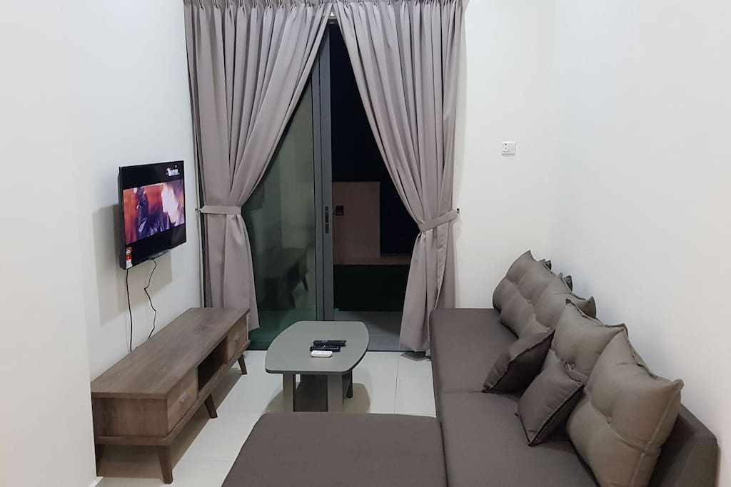 "Living room with cosy lounge set & 40"" TV with satellite receiver (Astro)"