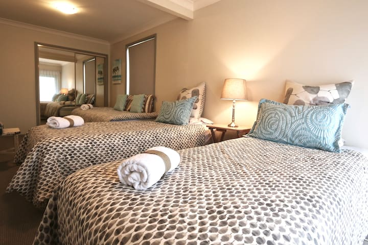 Bed 2  with 3 single beds and built in robe