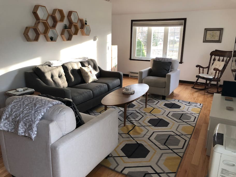 Sunny living room with queen sleeper sofa