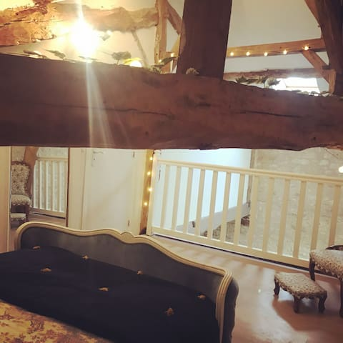 The beams in the mezzanine bedroom date over 200 years old