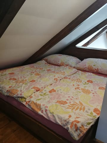 Double bed. Another bed for one person is located on the other side of the room. You can alternatively sleep downstairs where is a very comfortable folding bed for two people.