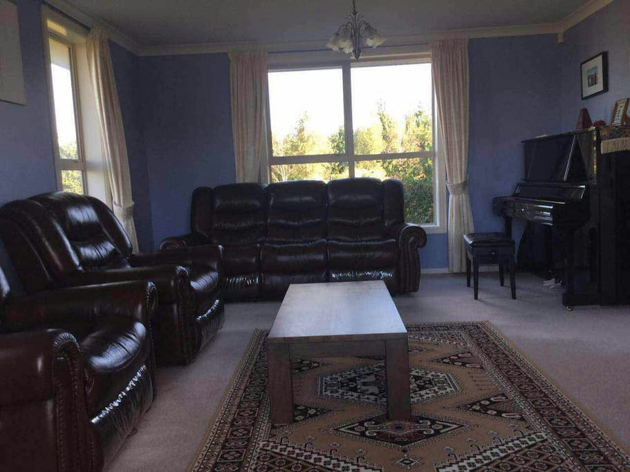 This is the secondary living room, with a U5 upright piano for your entertainment.