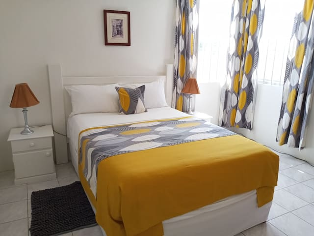 An ambient and cheerful setting to enjoy. Comfortable full size bed. Spacious bedroom with amble closet space. AC within the bedroom.