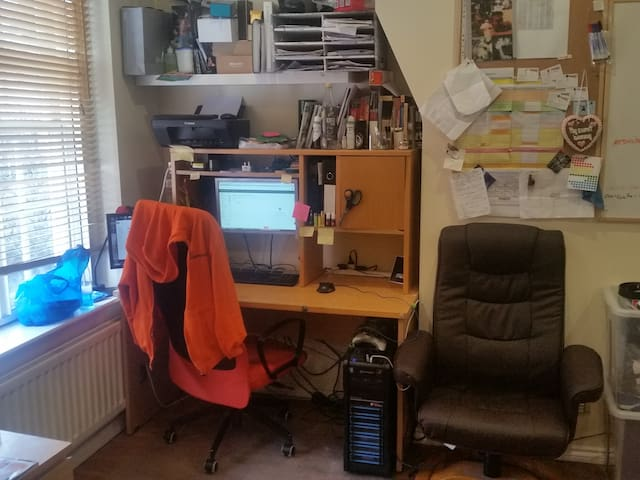 Desk to work on, with an extra recliner chair (has Massage feature too ;))