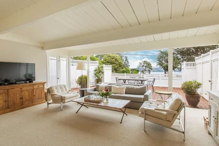Cozy home full of charm, large deck and bay view.