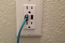 Receptacles with 2 USB plugs each - in bathroom, plus 2 in bedroom.