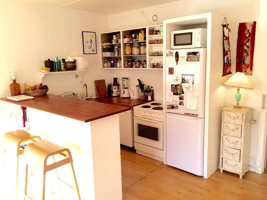 Fully functional kitchen, with bar table and chairs, fridge, freezer, oven, stove, juicer, blender, kettle, ect..