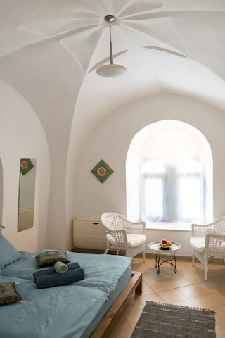 sleeping room with ancient arched ceiling