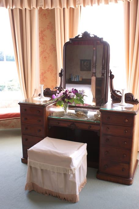 The dressing table in the bay window