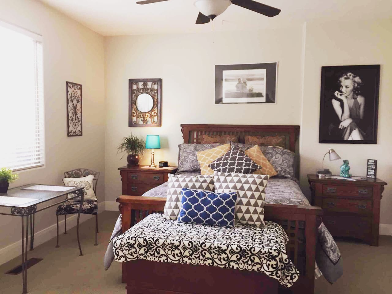 Comfortable Queen size bed with table and chairs for 2.