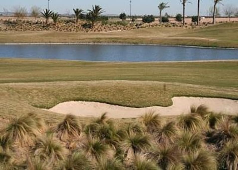 View of the golf course from the dual aspect balcony.