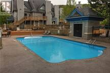 Family Friendly salt water pool and hot tub.  Lots of deck area with chairs and loungers. (No life guard on duty)