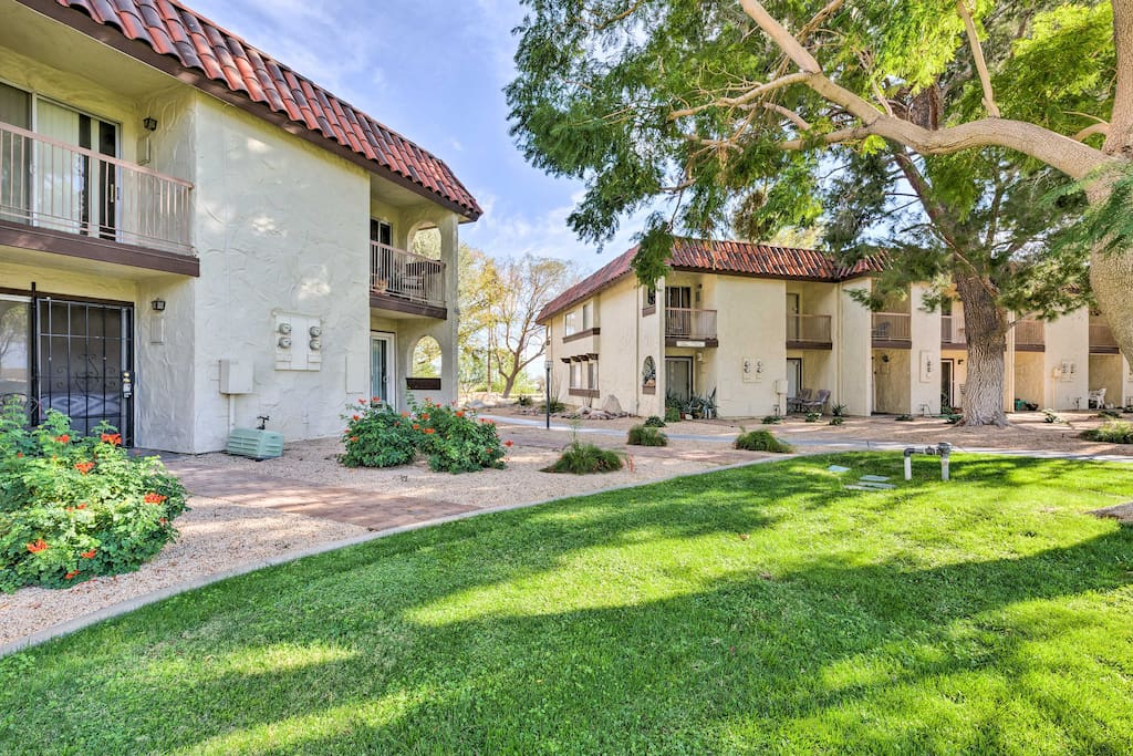 Meticulously manicured lawns surround the condo.