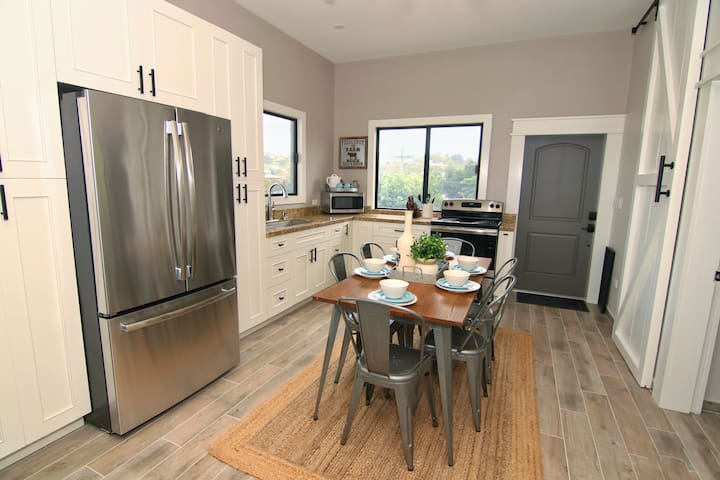 state of the art home with all the modern amenities including stainless steel, double dour fridge/freezer, coffeemaker, microwave, stove, kitchenware, dishware, and dining room. Iron and ironing board are also included.