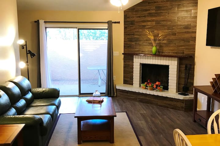 A real fireplace!, with enclosed patio and BBQ grill.