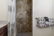 A beautifully tiled walk-in shower.