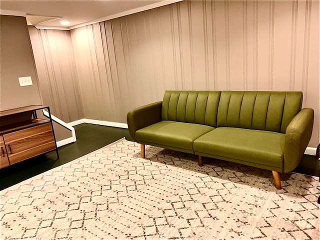 Basement - green couch is a futon