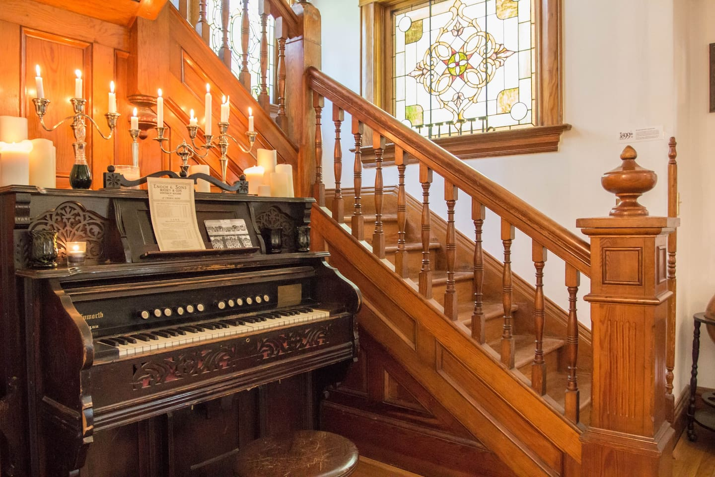 The stairs to the third-floor Music Room will lead you past original stained glass and a vintage 19th-century pump organ.