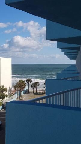 Beach front studio condo, with ocean & city views!