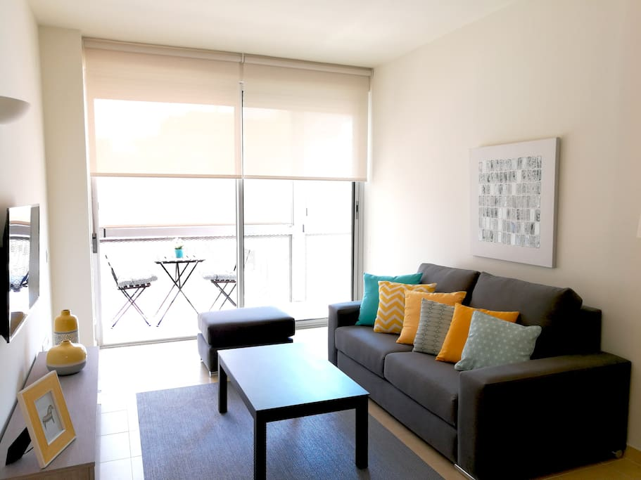 Sunny living room with balcony access and double living room