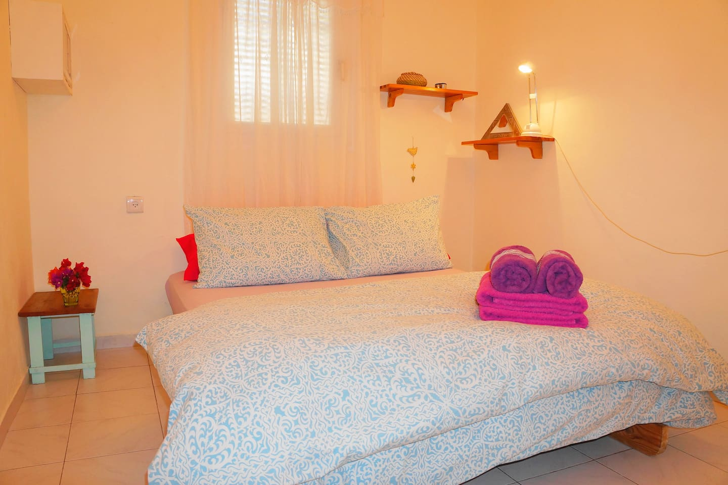 Relaxing sleeping area with double bed, aircon and double wardrobe.