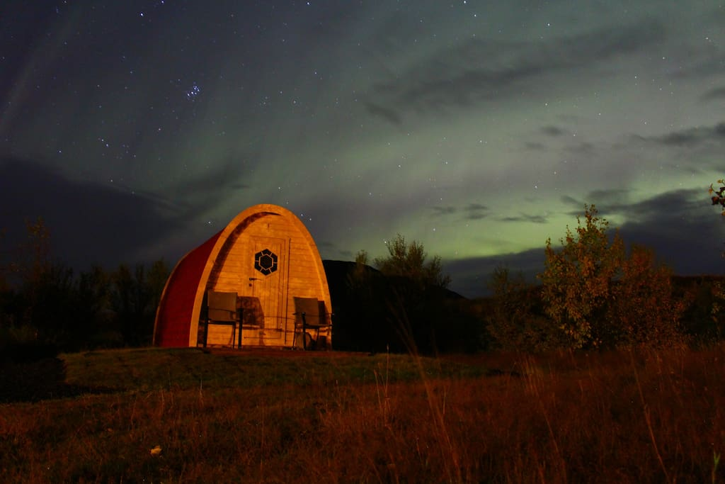 Pod under Northern Light sky