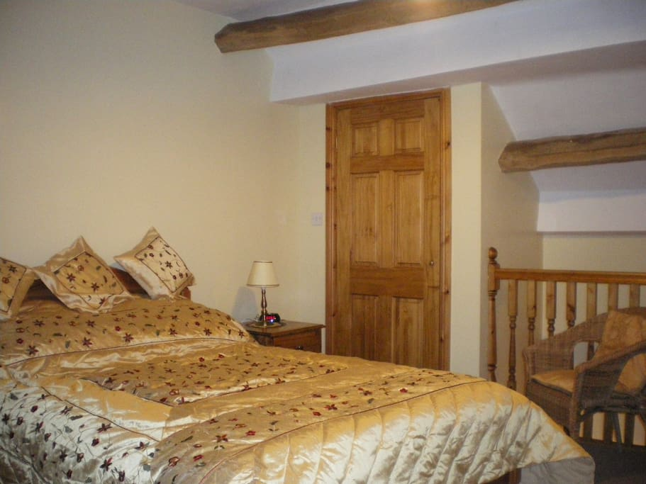 Bedroom of The Robins cottage with Kingsize bed