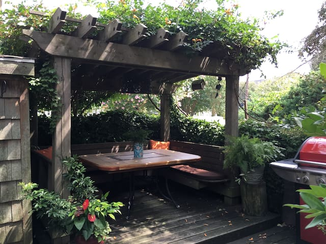 Grill up a dinner on the propane grill or enjoy morning coffee in the outdoor dining pergola.