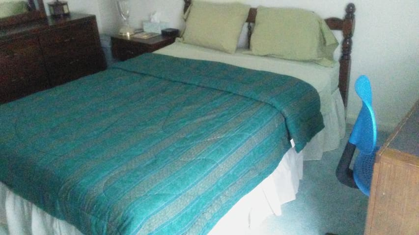 Comfortable queen size bed with pillows and blanket as needed.  Only one guest allowed.  Desk w/chair, closet, dresser and chest, night table, ceiling fan with light and remote.