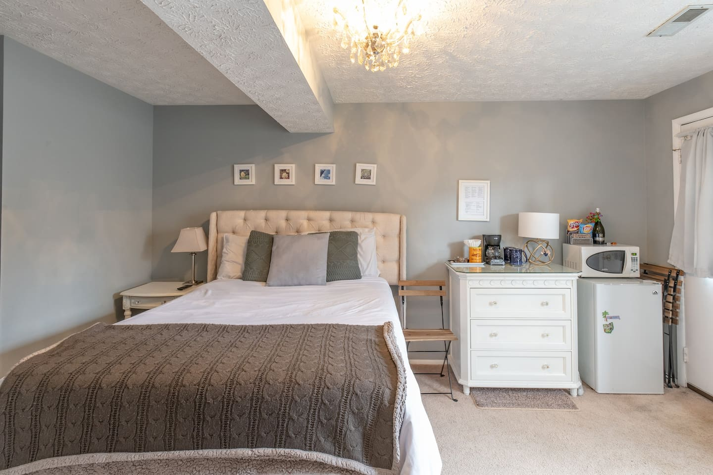 Private bedroom with 1080p HDTV, coffee maker, memory foam bed, snacks, microwave, fridge, wine, water, and much more!  Helpful tips and information are in the white picture frame above the coffee maker.