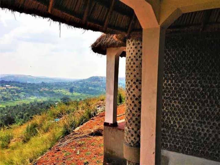 Upcycled Plastic Bottle Houses on top of a Hill