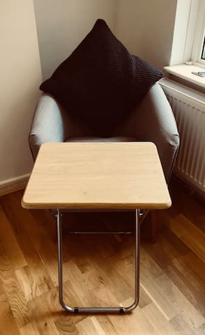 Fold away table for a lap top or for meal times