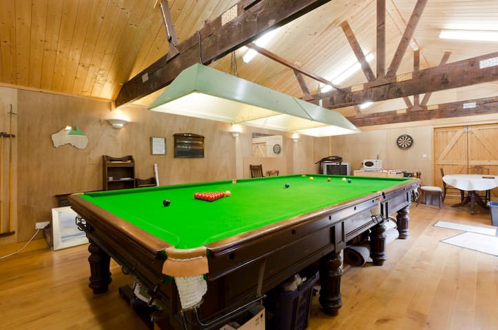 100 year old snooker table. Dartboard, table football.