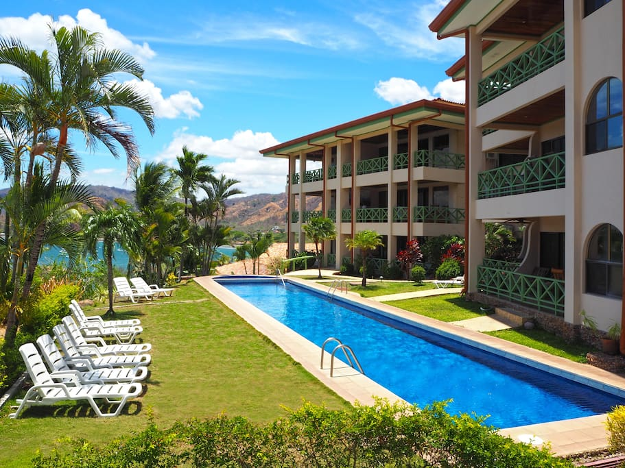 Large, well-maintained lap pool has fantastic bird's eye views of the surrounding ocean and mountains