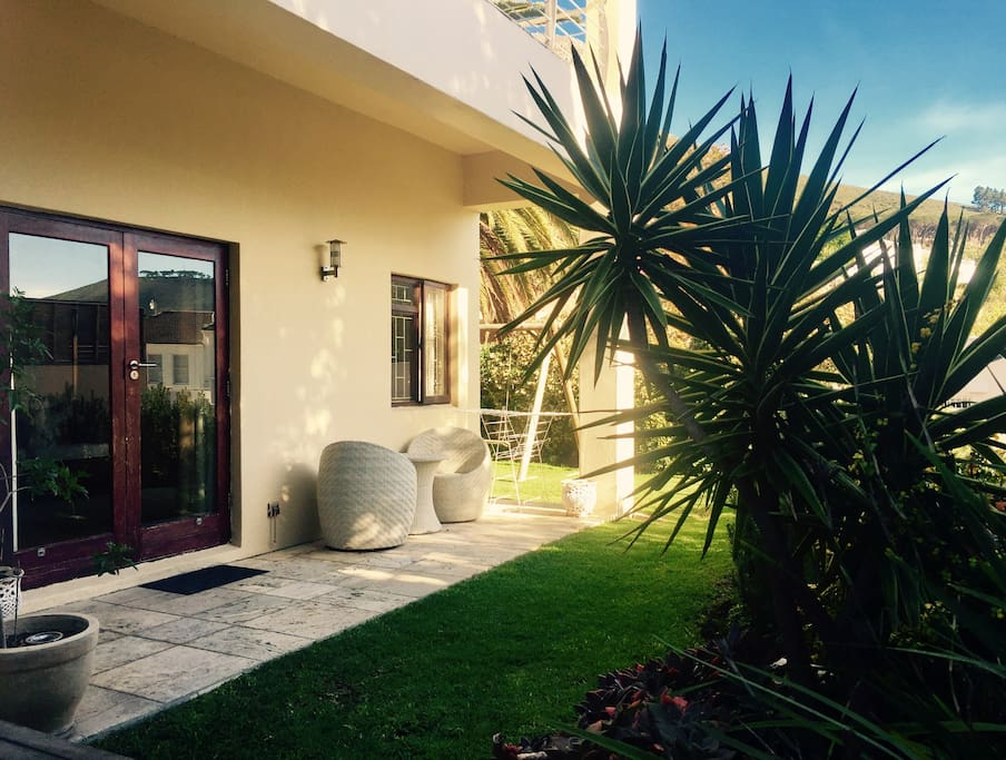 Private entrance to the apartment with a small garden. Outside seating area with Weber braai