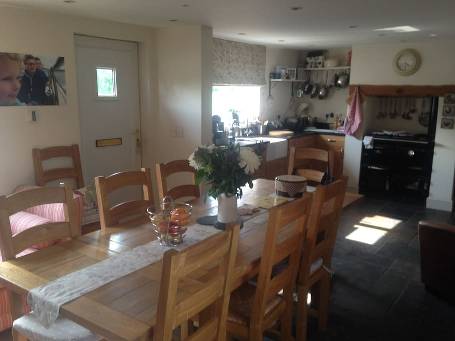 Large spacious kitchen with range cooker and log burning stove