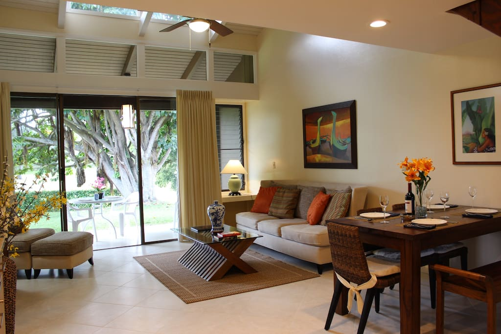 Beautiful open layout living area with high ceilings, full windows and a outdoor patio to enjoy meals on.