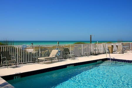 The Beach condo #107,  PRIVATE BEACH OPEN