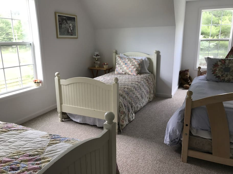 This upstairs room has three twins and a trudle bed