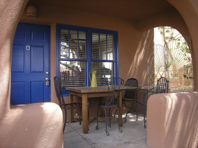 Covered patio with seating for 4