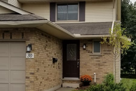 Cozy Condo steps from Conestoga Mall