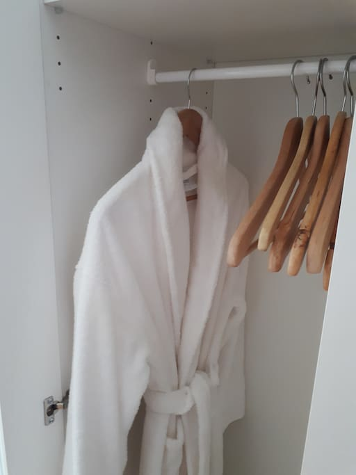 Wardrobe to store your clothes and a fluffy robe to wrap yourself in.