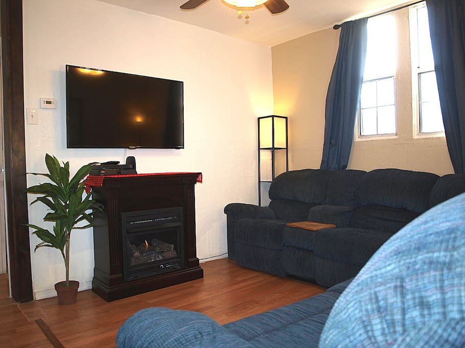 "Fireplace, 50"" TV, Blu Ray DVD player, wireless internet and comfortable sofa."