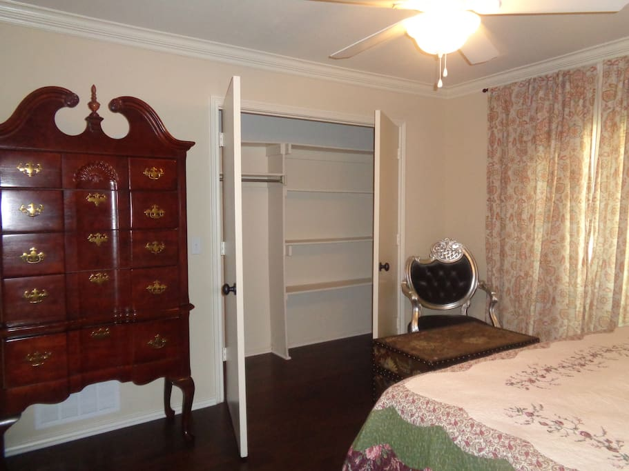 Private bedroom, with chest and large closet.