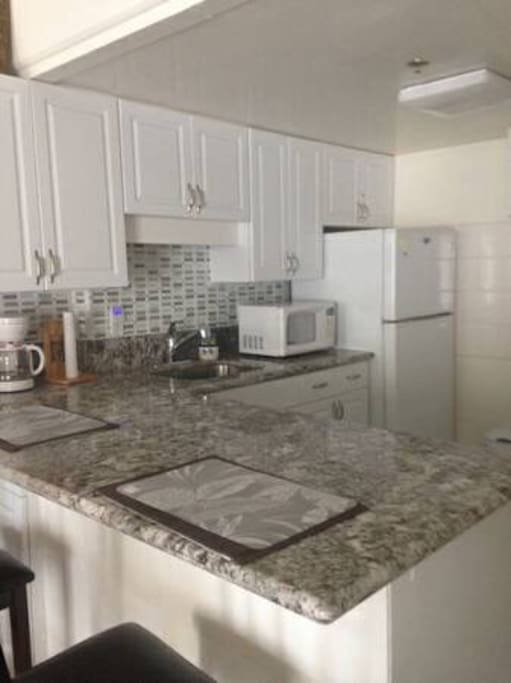 Fully stocked kitchen with granite countertop and new appliances