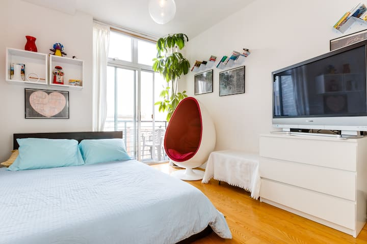 """Your bedroom features a queen-sized Casper bed, private balcony, egg chair, and TV w all premium cable channels  Kim reviews: """"Loved Seth's place, I think he has one of the most comfortable beds I have ever experienced in my life-which was wonderful after walking around so much."""""""