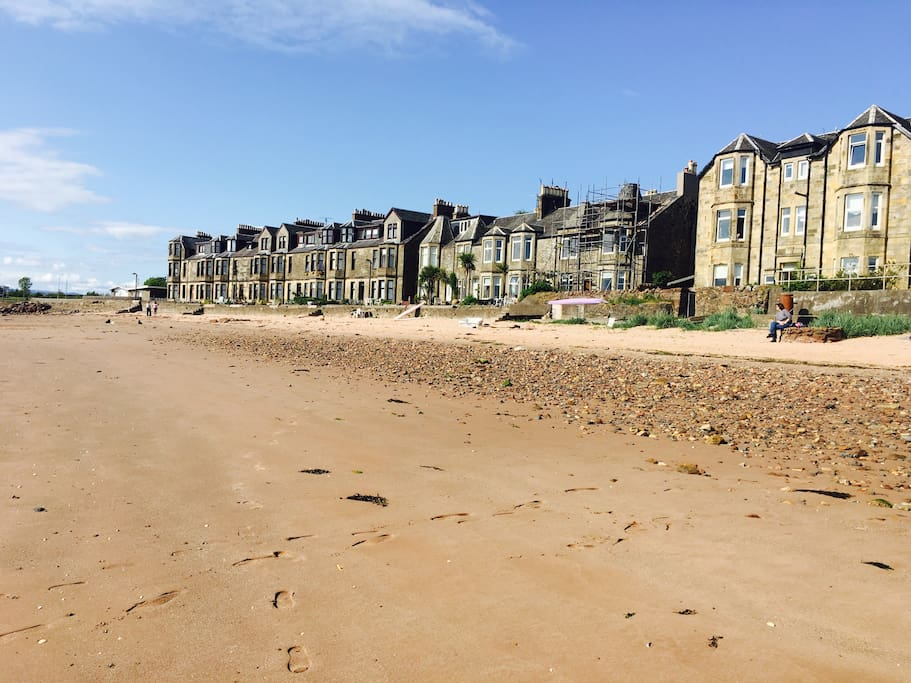 View of our apartment (the big Victorian building on the right) and Allanton Park Terrace to the left at low tide from the beach.