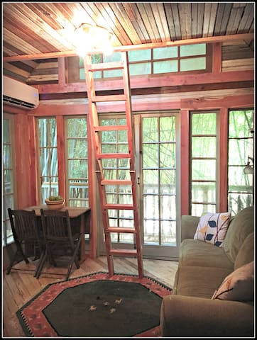Treehouse lounging area and cedar ladder.  Our treehouse smells deliciously of fresh cedar.
